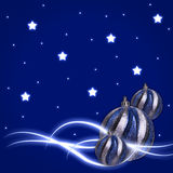 Glow stars Christmas balls. Blue background with glow stars Christmas balls Stock Photography