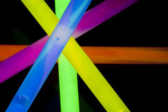 Glow Sticks Closeup. Red, Blue, Yellow, Green, and Orange Glow Sticks in a Criss Cross pattern closeup Stock Image