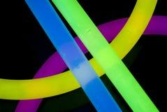 Glow Sticks Closeup. Red, Blue, Yellow, Green, and Orange Glow Sticks in a Criss Cross pattern closeup Stock Photography