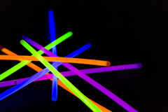 Glow sticks fluorescent lights. Glow sticks neon light fluorescent on back background. variation of different colored chem lights Royalty Free Stock Photography
