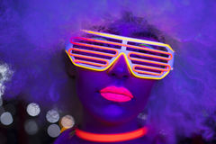 Glow uv neon disco female cyber doll robot electronic toy. Fantastic video of cyber raver woman filmed in fluorescent clothing under UV black light stock photography