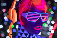 Glow uv neon disco female cyber doll robot electronic toy. Fantastic video of cyber raver woman filmed in fluorescent clothing under UV black light stock images