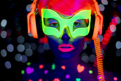 Glow uv neon disco female cyber doll robot electronic toy. Fantastic video of cyber raver woman filmed in fluorescent clothing under UV black light royalty free stock images
