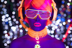 Glow uv neon disco female cyber doll robot electronic toy. Fantastic video of cyber raver woman filmed in fluorescent clothing under UV black light stock photos