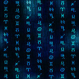 Glow zodiac symbols on navy blue blur background. Royalty Free Stock Image