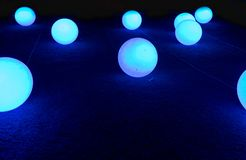 Free Glowed Balls On Blue Background Royalty Free Stock Photography - 136487087