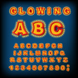 Glowing ABC. Light font. Retro Alphabet with lamps. font pointer Stock Photos