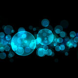 Glowing abstract background. Glowing abstract cyan bokeh lights over black background Royalty Free Stock Photos