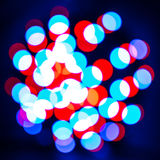 Glowing abstract light spots on dark Royalty Free Stock Photography