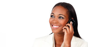 Glowing Afro-american businesswoman on phone Stock Photo