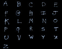 Glowing Alphabet Stock Images