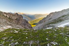 Glowing alpine valley and flowering meadow Royalty Free Stock Photos