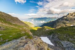 Glowing alpine valley at sunset from above Royalty Free Stock Image