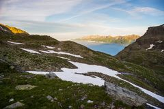 Glowing alpine valley at sunset from above Royalty Free Stock Photo