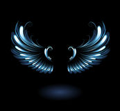 Glowing angel wings. Glowing, stylized angel wings on a black background Stock Photography