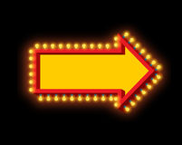 Glowing arrow with lamps. Luminous pointer. Retro cursor with li Royalty Free Stock Photography