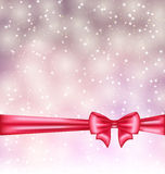 Glowing background with gift bow ribbon Royalty Free Stock Images
