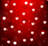 Glowing background with glowing hearts Royalty Free Stock Image