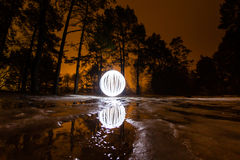 Glowing ball on the melting ice in the spring forest Royalty Free Stock Image