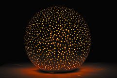 Glowing Ball-Shaped Candle Holder in the Dark Royalty Free Stock Images