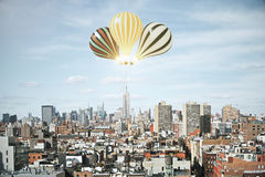 Glowing baloons in tthe sky above megapolis city Stock Photography