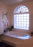 Glowing Bath. Glowing light in an elegant and inviting bathroom Royalty Free Stock Photo