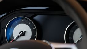 Glowing beautiful dashboard of a modern expensive car. The interior of the car royalty free stock images