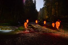 Glowing beehives on riverside Stock Image