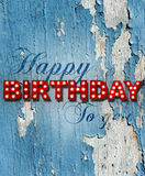 Glowing birthday greetings over distressed paint. Grunge painted background with glowing letters writing Happy Birthday to you royalty free stock photography