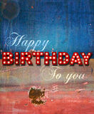 Glowing birthday greetings over distressed paint Royalty Free Stock Photography