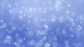 Glowing blue bokeh background. Beautiful glowing blue bokeh background with floating light particles stock footage