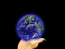 Glowing blue globe on hand Stock Photo