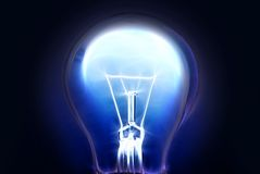 Glowing blue lamp on black. Background stock photos