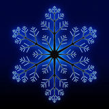 Glowing blue snowflake Royalty Free Stock Image