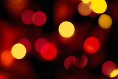 Glowing blurred light, bokeh effect. Warm blurred light of christmas tree royalty free stock image