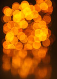 Glowing Bokeh Lights Background with Reflection Stock Photos