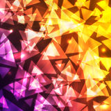 Glowing bokeh triangular shapes on a dark gradient background Stock Images