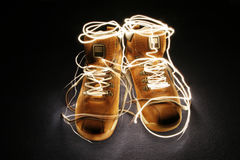 Glowing boots Royalty Free Stock Image