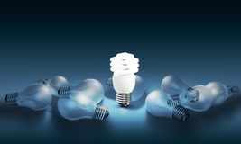 Glowing bright light bulb among others Stock Photos
