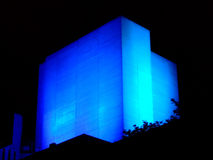 Glowing building. Blue glowing building at night royalty free stock images