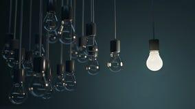 Glowing bulb among the grey Stock Photo
