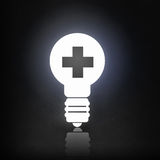 Glowing bulb icon. Cross light bulb glowing icon on dark background Royalty Free Stock Images