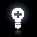 Glowing bulb icon. Cross light bulb glowing icon on dark background Stock Photo