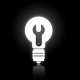 Glowing bulb icon. Light bulb icon with tool sign on black background Stock Photo