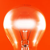 Glowing Bulb on Red Stock Photo