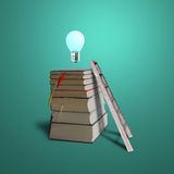 Glowing bulb on top of stack books with ladder, green background Stock Photo
