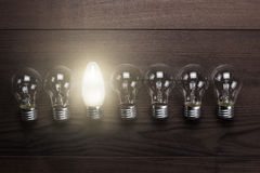 Glowing bulb uniqueness concept royalty free stock photo