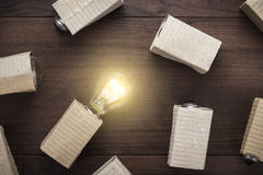 Glowing bulb uniqueness concept on wooden background Stock Image