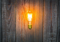 Glowing bulb on the wood Royalty Free Stock Photos