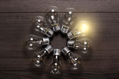 Glowing bulb on wooden background Royalty Free Stock Photography